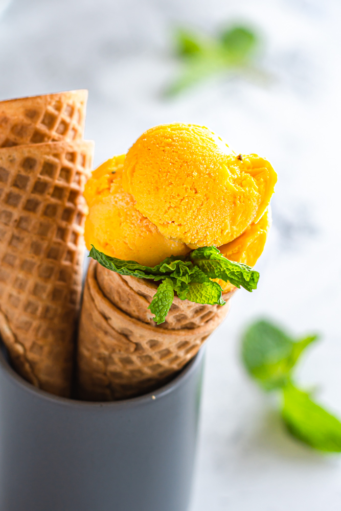 Mango Coconut Ice Cream in a cone.