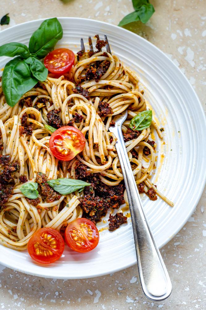 Sun Dried Tomato Pesto spaghetti in a white plate.