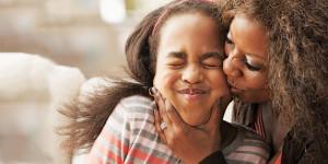 Raise Your Child's Self-Esteem - Mother kissing Daughter