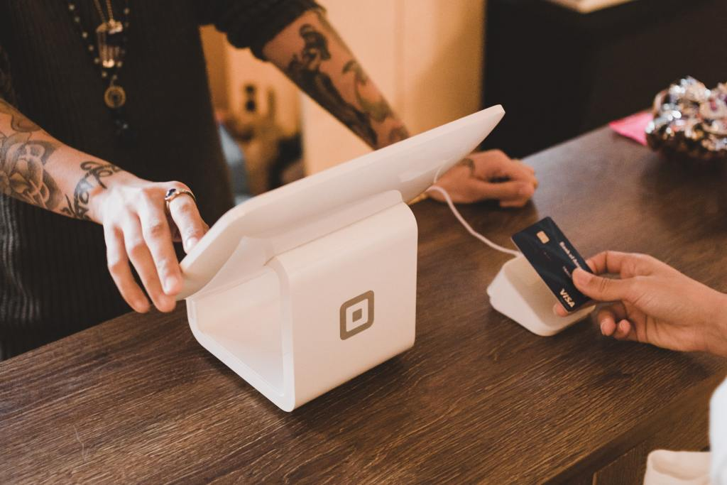 a consumer using Square at a checkout counter