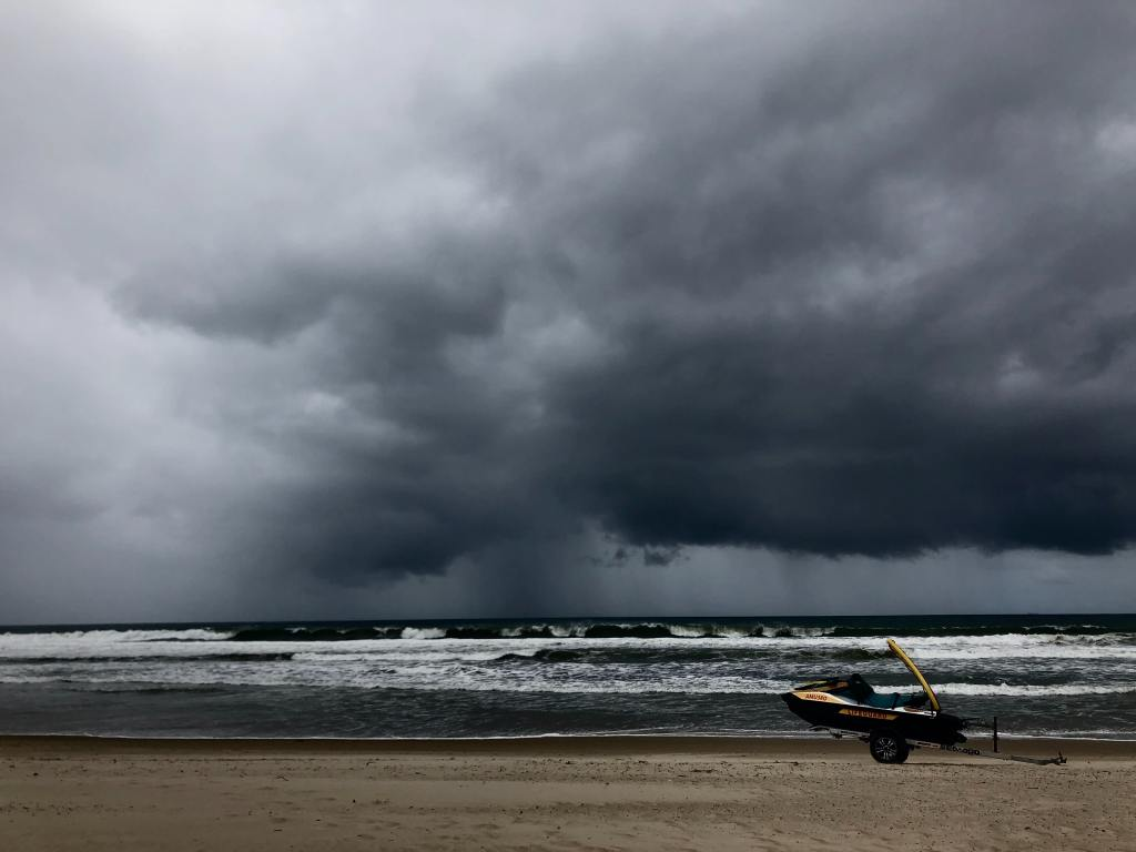 storm over the ocean with heavy rainfall