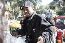 Ben Johnson III sells vegetables with his family on St. Helena Island, S.C. Most customers are relatives or repeat customers who want to savor a bit of the island.