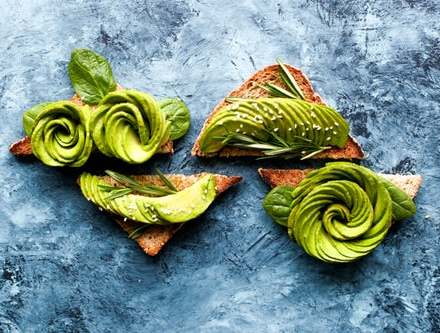 Artistic healthy foods avocado spread over toast