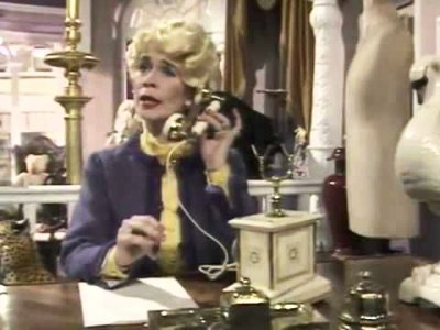 Celia Imrie as Miss Babs, on the phone