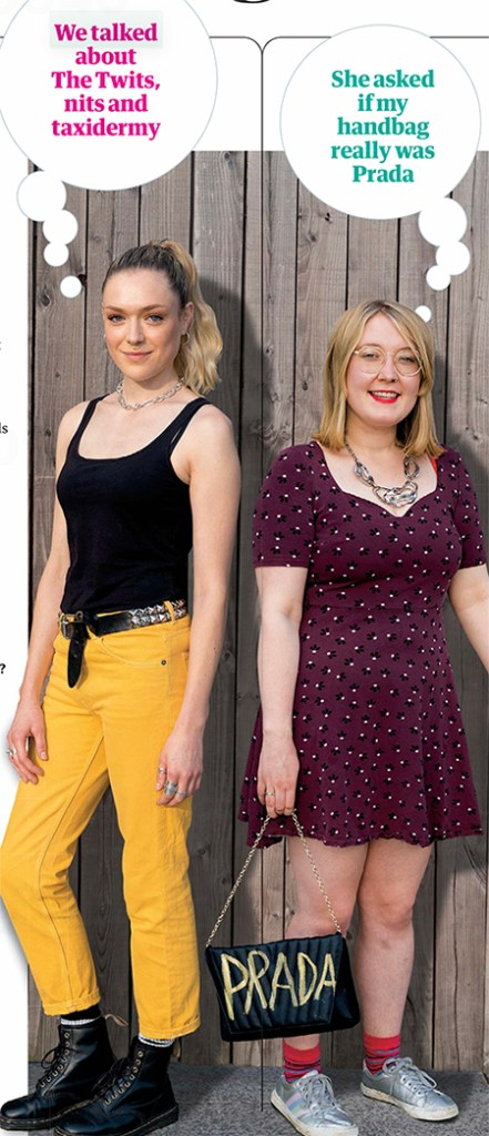 Poppy and Lucy full length – Poppy is in a black vest and yellow trousers, Lucy is in a dress, carrying a bag which has PRADA scrawled on it, possibly homemade