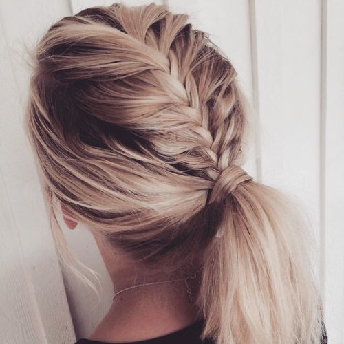 White ponytail hairstyle with dark roots