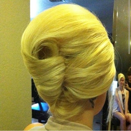 Bright yellow seashell updo hairstyle