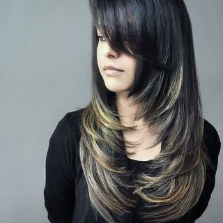 Stylish layered haircut with oblique bangs