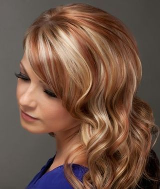 The reddish blonde + white-golden highlights on the wavy hair