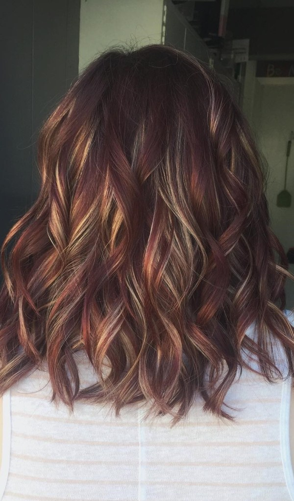 Burgundy and blonde waved streaks