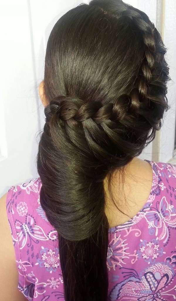Waterfall braid with an involute ponytail.