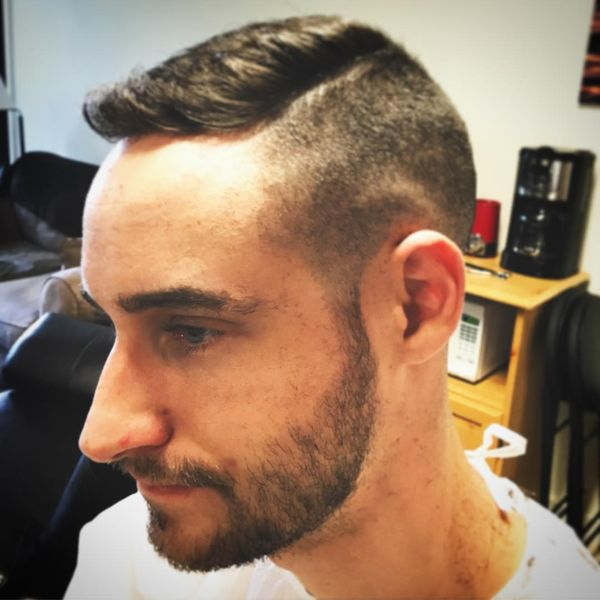 Raised forelock plus a side part line