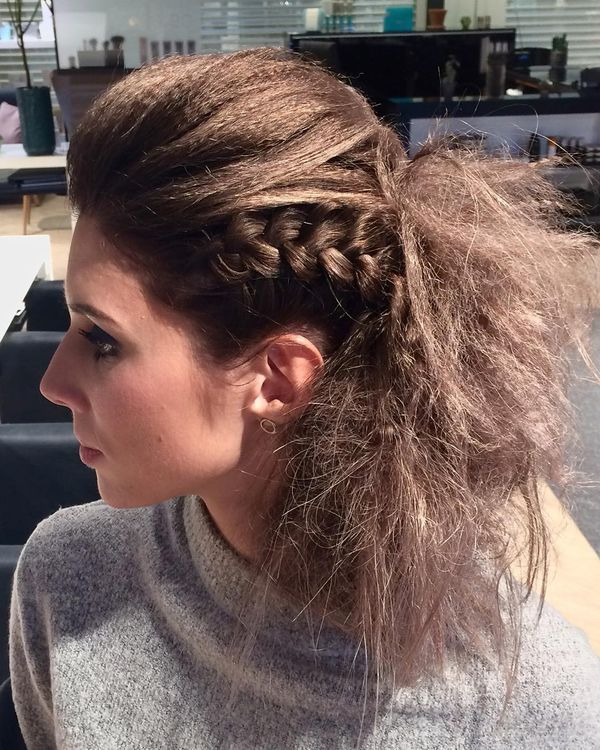 Wild hairstyle with a bouffant ponytail and a side braid