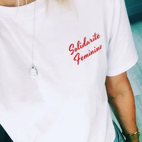 White tshirt with Solidarite Feminine logo