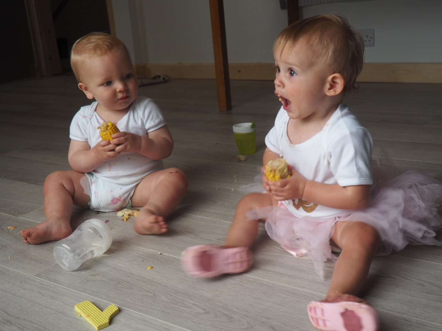 a boy and girl baby eating sweetcorn in white vests| Letters to Ettie
