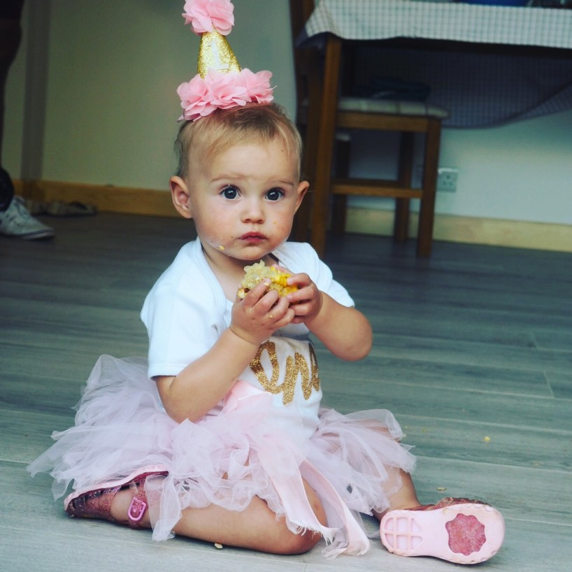 girl in pink tutu and 1 birthay hat