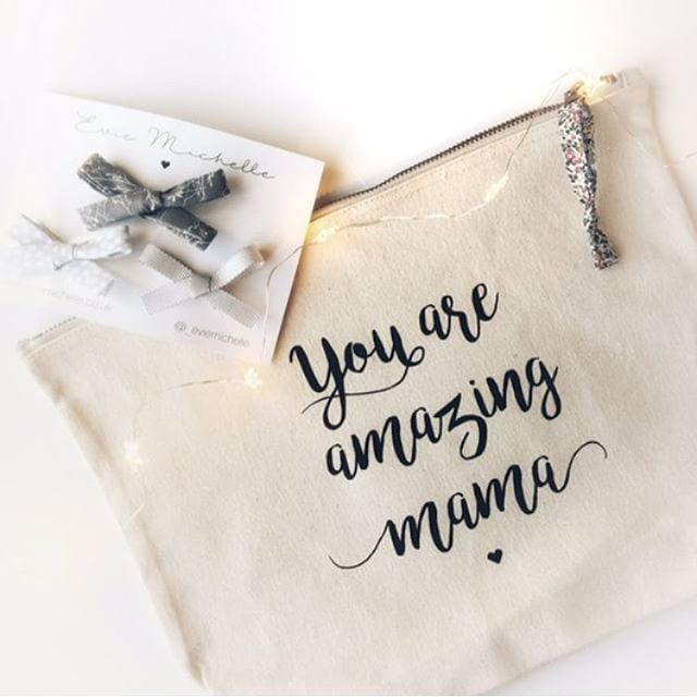 cream zip pouch with 'you amazing mama' written on it