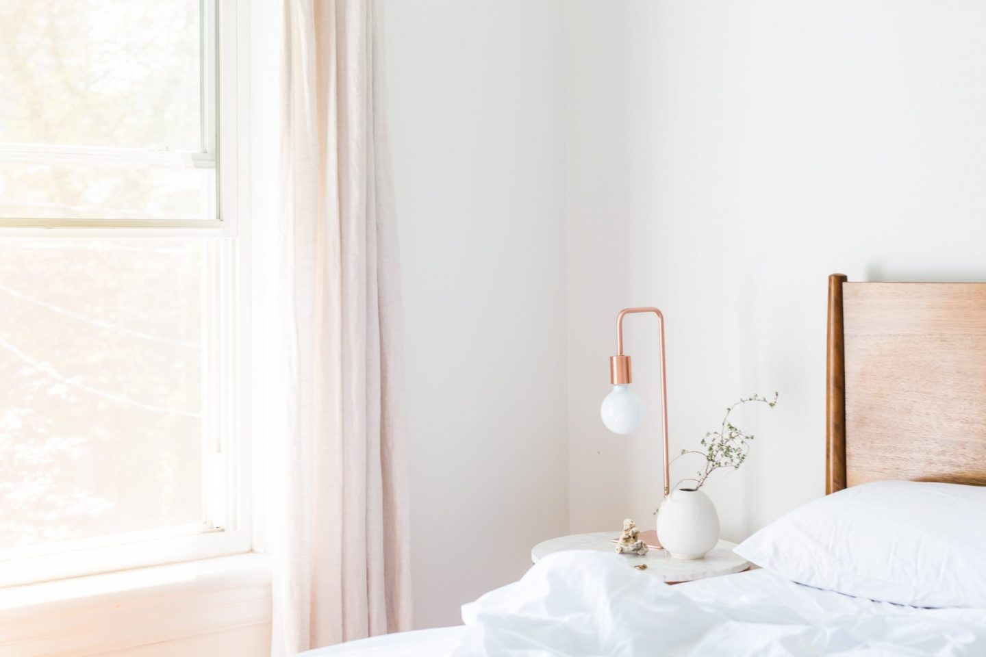 Creating a bright and airy bedroom using curtains
