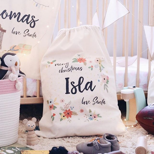 Handpainted cream Santa Sack personalised with the name Isla by Daydreams and Dandelions