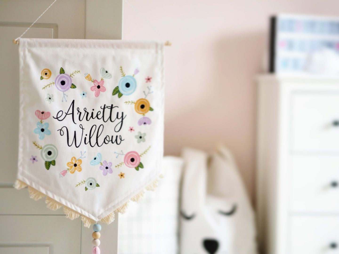 Handpainted wall banner with pastel flowers personalised with the name Arrietty by Daydreams and Dandelions | A Modern Pink Girls room with a Scandinavian twist | The Halcyon Years