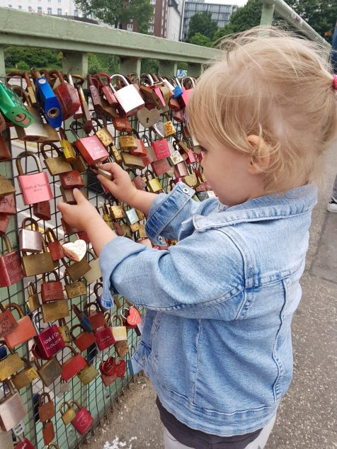 Toddler playing with locks on bridge | Hamburg with a toddler