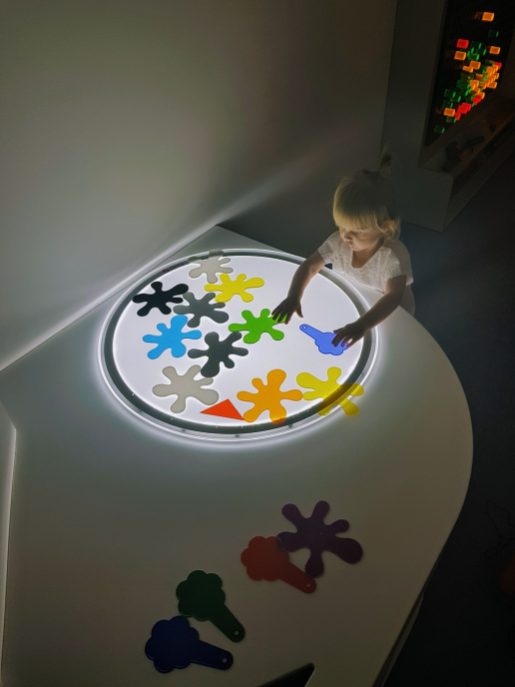 little girl at light show inside Kids at Work, Hamburg with a Toddler | The Halcyon Years