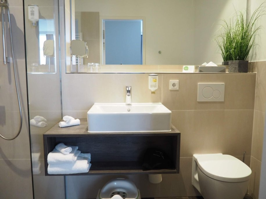 Bathroom in Appartello hotel | Hamburg with a toddler