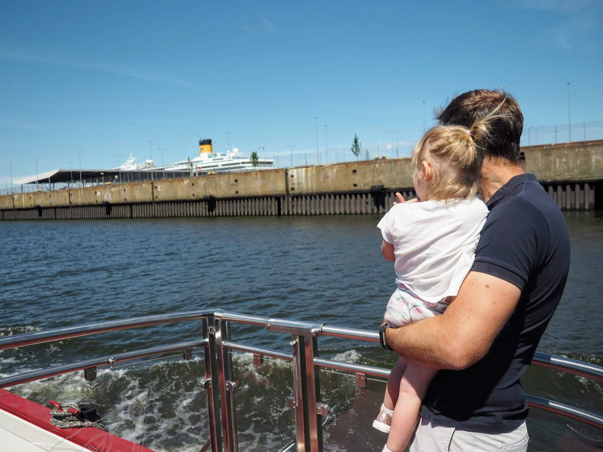 Father and daughter looking out over river   Hamburg with a toddler