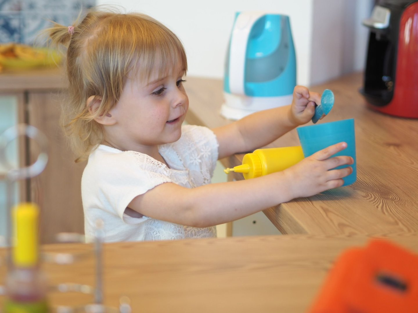 Little girl playing in pretend kitchen, Kids at work, Hamburg with a Toddler   Ettie and Me