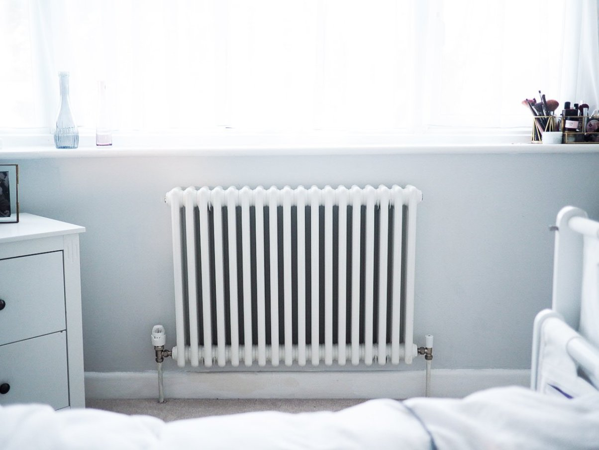White radiator against grey wall | improving the efficiency of your central heating system | Ettie and me