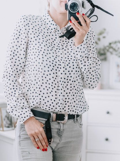 Boden staples for a capsule weekend wardrobe | The Halcyon Years [lady wearing white and blue polka dot shirt)
