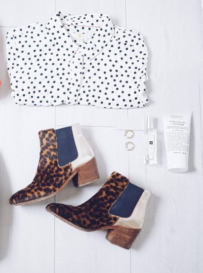Boden staples for a capsule weekend wardrobe | The Halcyon Years (flat lay of leopard print boots and ladies white polka dot shirt)