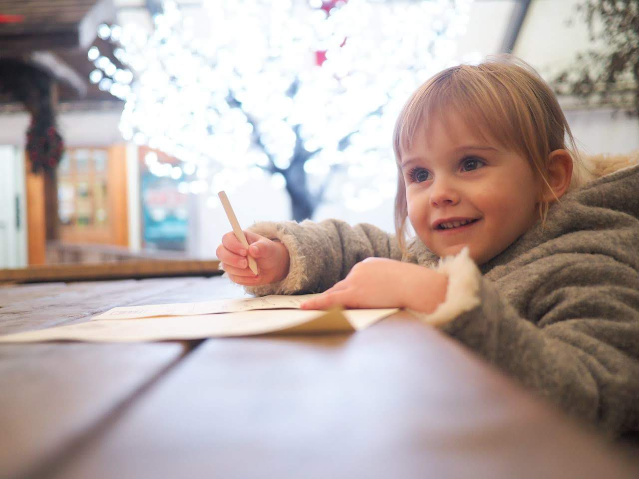 little girl writing a letter to santa | Tulleys Farm Sussex | The Halcyon Years