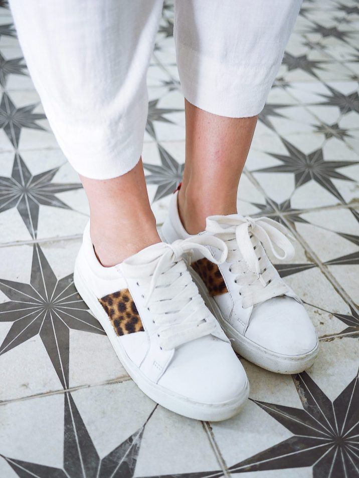white trainers on star floor tiles