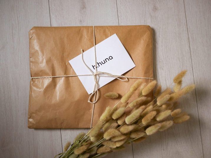 brown paper package with hhuna card on top