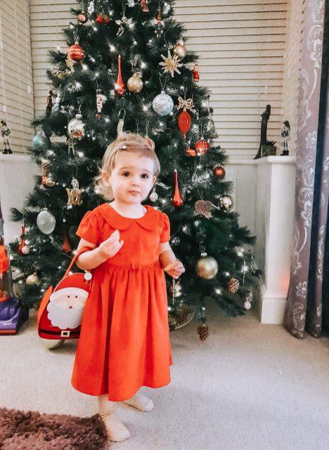 Toddler girl in red christmas dress