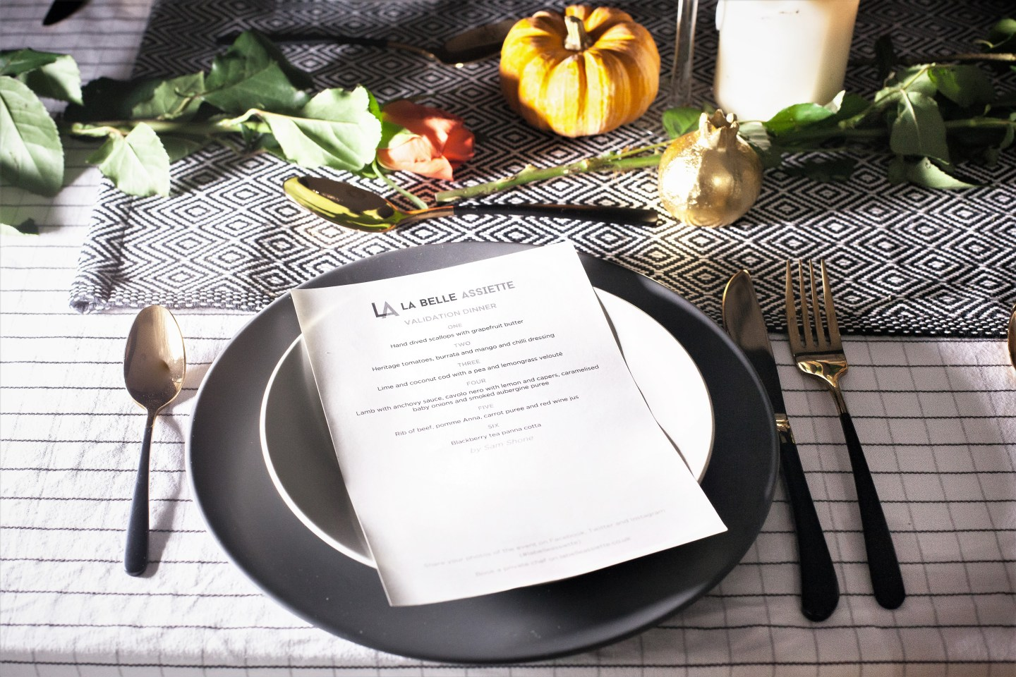 La Belle Assiette Menu placed on top of a grey plate