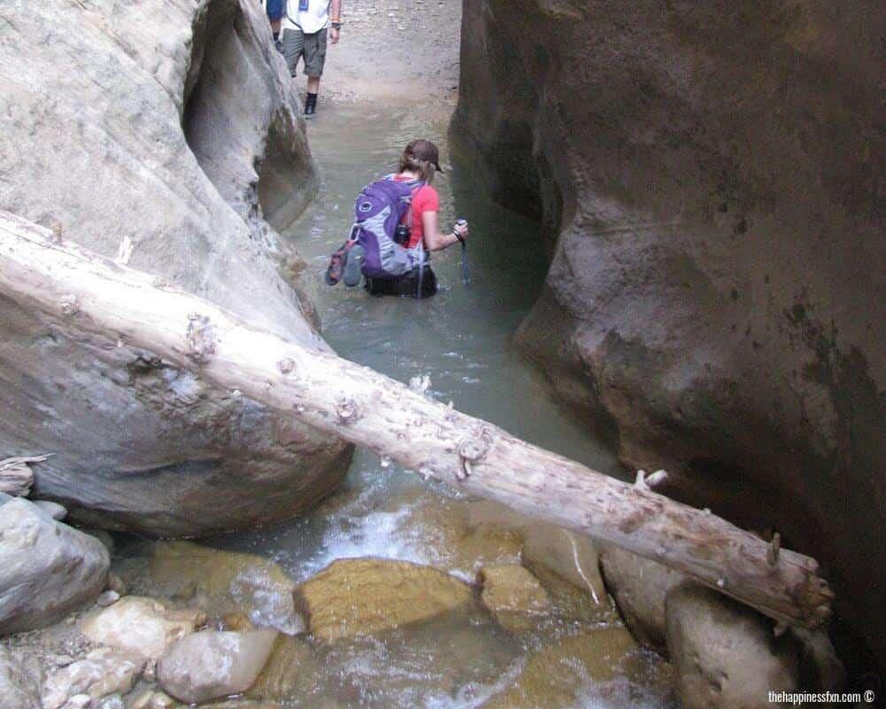 orderville-canyon-utah-girl-wading-through-water