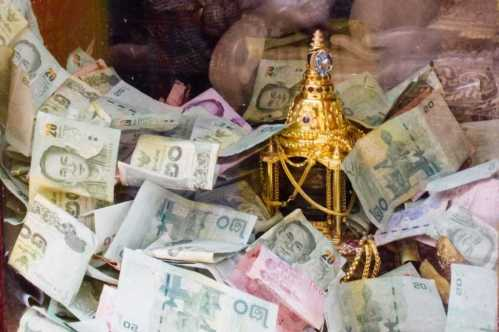 Baht Money offerings temple bank notes