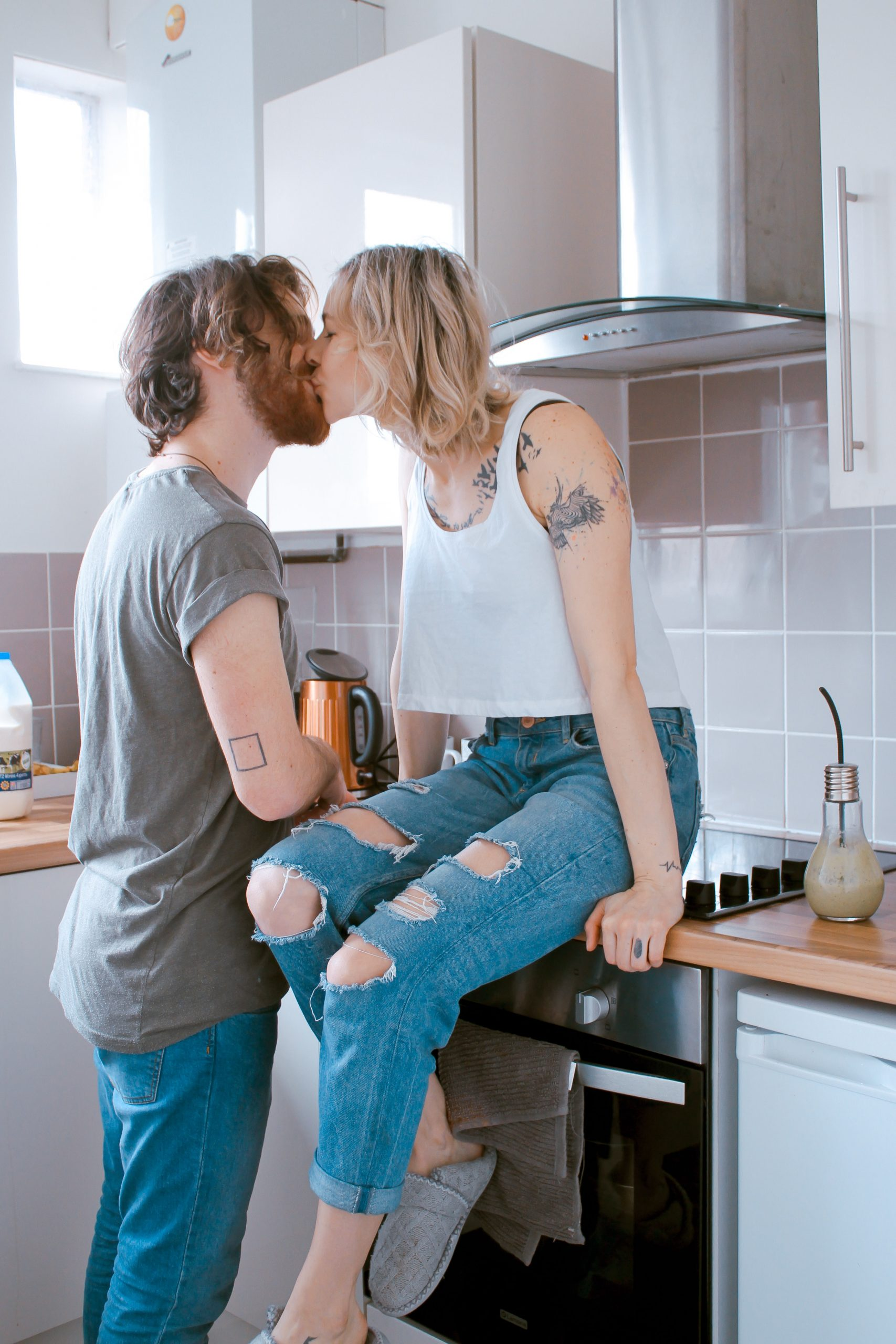 Couple kissing at home