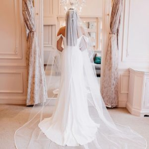 The Amour single tier classic tulle veil with a satin edge and in a flattering love-heart shape is a bestseller. Click to shop.