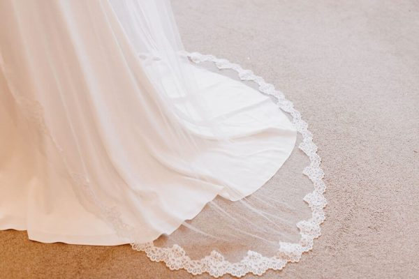 This beautiful single tier vintage tulle with Camilla Edging to the Fingertip veil would look stunning on any bride. Click to shop.