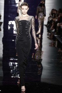 Reem Acra's edgy but sophisticated take on the classic black gown. Photo via Women's Wear Daily.