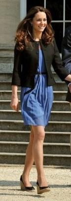 Wearing a Zara dress with a Ralph Lauren blazer the day after her wedding.