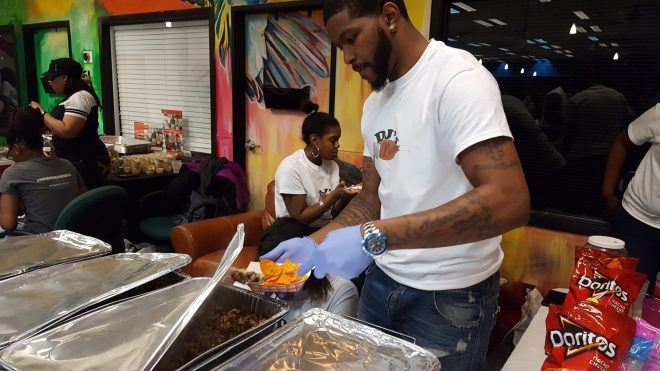 DJ of DJ's Jerk Everything a Black chef from Chicago featured at Foodie Heaven
