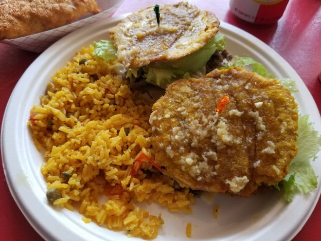 jibarito sandwich with rice and empanada
