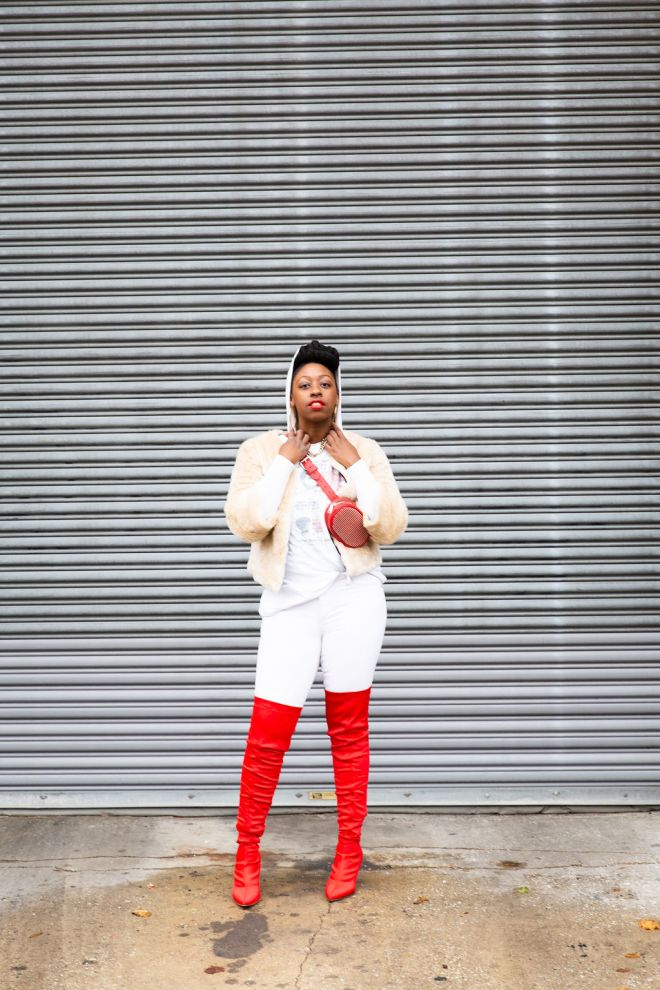 girl with hood on her head-standing in red boots and a white outfit-the haute seeker