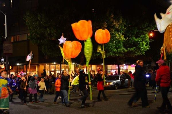 People walking with illuminated sculptures. Image seen in the March Guide of Events in Chicago 2019 on TheHauteSeeker.com