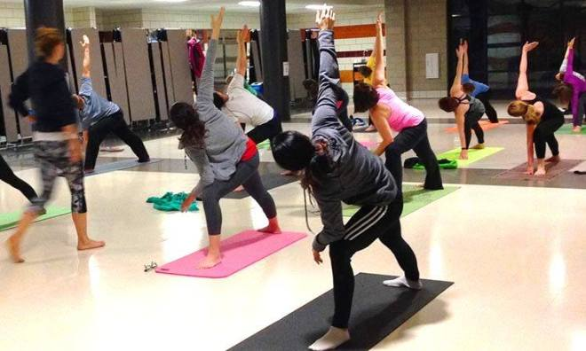 Image of women practicing yoga at the Chicago Park District facility as featured in the January Events Guide for 2020 by The Haute Seeker
