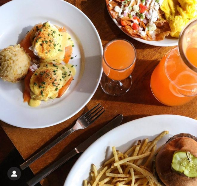 Benedicts and mimosas at Hutch American Bistro in Chicago as featured in The Haute Seeker Bottomless Brunch Guide